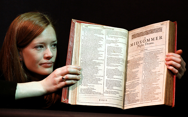 """A Christie's member of staff displays an unrecorded copy of the First Folio, the first collected edition of Shakespeare's plays, widely considered the most important literary publication in the English language, in London, Wednesday, March 16, 2016. The book contains 36 plays, 18 of which appear here for the first time in print, and is estimated at 800,000-1.2 million UK pounds (1,127,760- 1.69 million US dollars). William Shakespeare died 400 years ago, but his stock has never been higher. To coincide with the anniversary of the Bard's death, Christie's is selling copies of the first four editions of his plays - a collection the auctioneer's head of books, Margaret Ford, calls """"the holy grail of publishing."""" The four folios are going on display in New York April 1-8 and London April 20-28 before being sold in London on May 25. (AP Photo/Kirsty Wigglesworth)"""